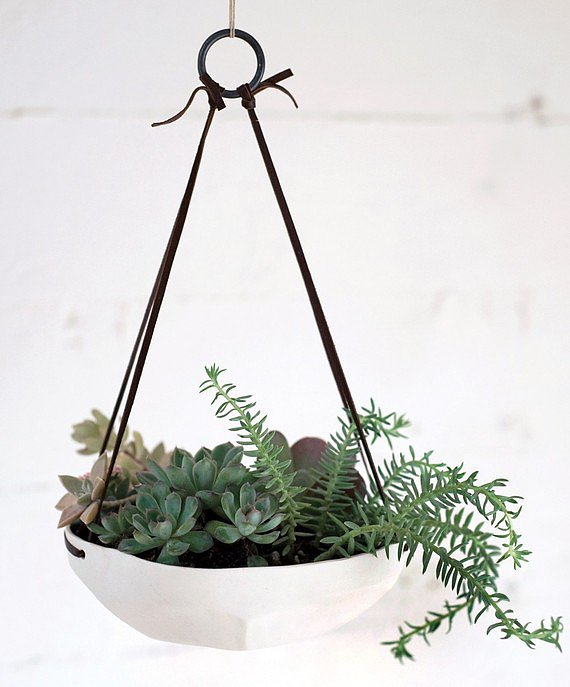 This shallow, unglazed planter ($76) looks great with plants, but we can also imagine using it in the kitchen as a hanging fruit bowl.