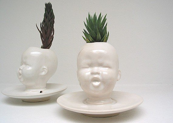 I'm sorry, what? We'll take two of these baby head planters ($38), because one would not be enough.