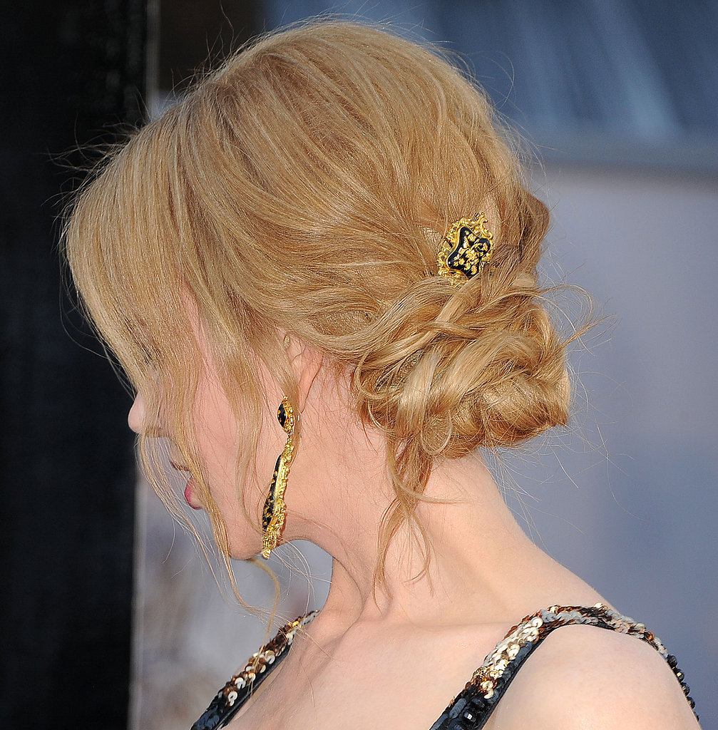 A piecey bun looks even more impressive embellished with a simply glamourous hair accessory.