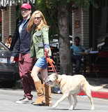 Jon Hamm and Jennifer Westfeldt Cuddle Up With Their Pup