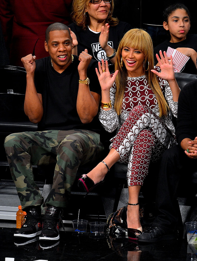 Beyoncé chose a head-to-toe printed Tibi ensemble, while Jay-Z styled camouflage pants with a black tee for a courtside appearance in November 2012.