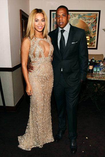 At the NYC premiere of Beyoncé's HBO documentary, Life Is But a Dream, the couple delivered black-tie elegance, she in a gold cutout Elie Saab gown and he in a black suit with a checkered shirt.