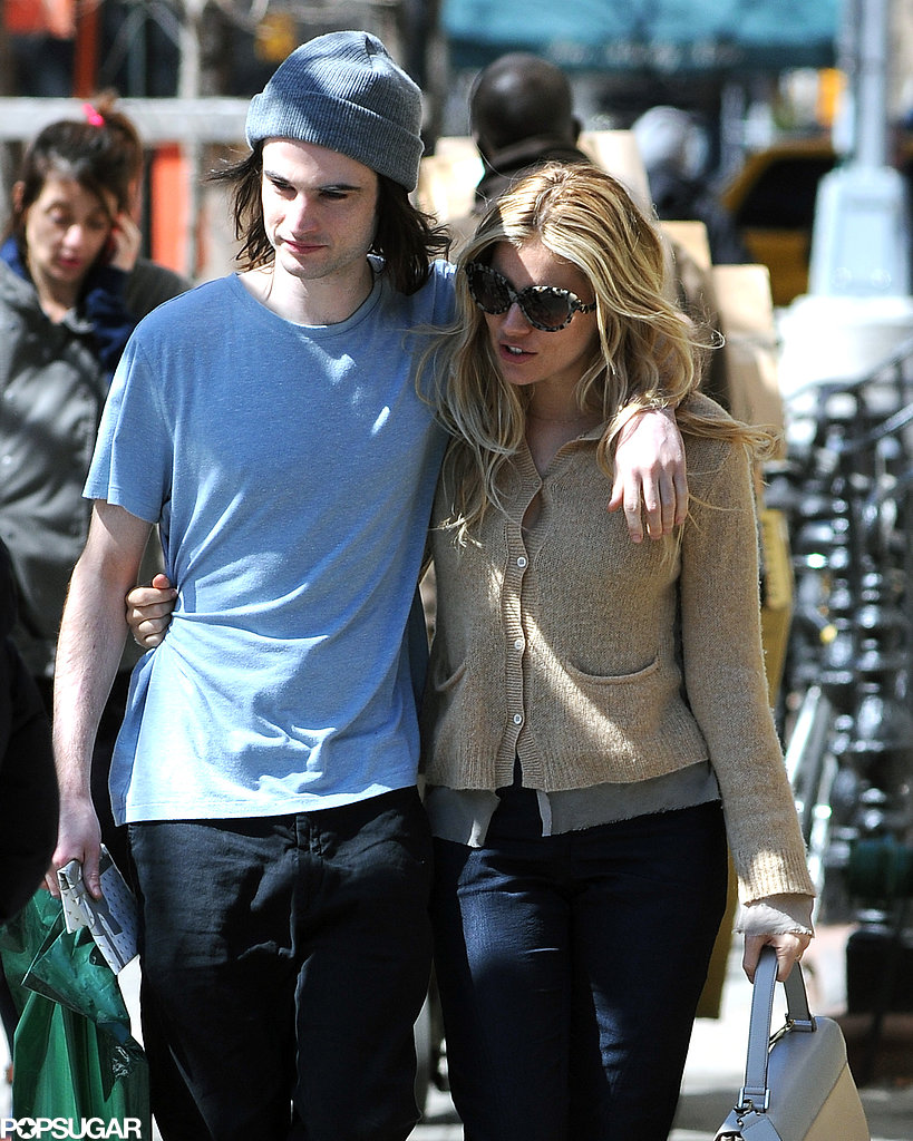 Tom Sturridge cuddled up to Sienna Miller in NYC on Wednesday.