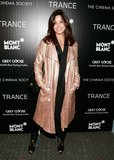 Gina Gershon wore a metallic coat.
