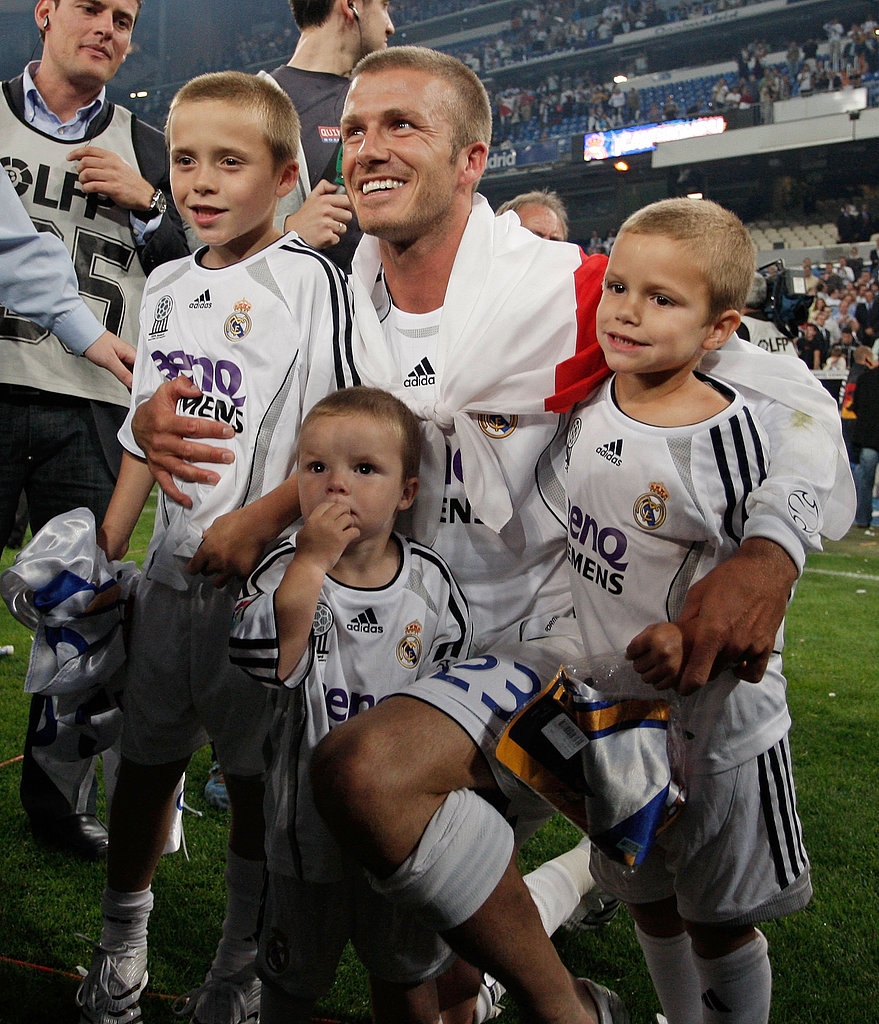 The boys joined David Beckham on the field in Spain for a family celebration after his team, Real Madrid, won their July 2007 match.