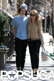 Tom Sturridge and Sienna Miller wrapped their arms around each other in NYC on Wednesday.