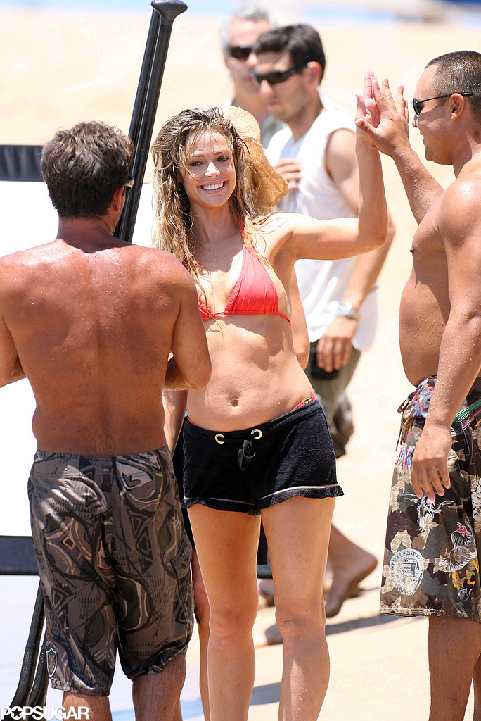 In April 2008, Denise Richards gave a male friend a high five during a beach trip in Maui.