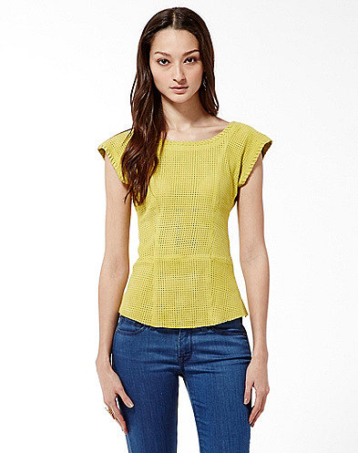This Lucky suede perforated top ($299) has a sporty feel with a more polished finish.