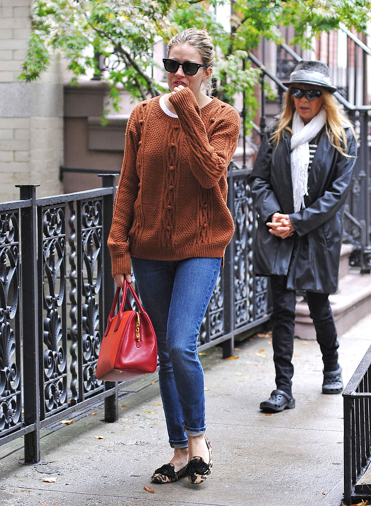 Sienna sported a burnt orange sweater with skinny jeans, a red-and-orange colorblocked bag, and her leopard loafers in NYC.