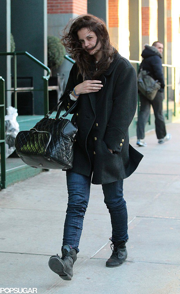Katie Holmes battled the wind.