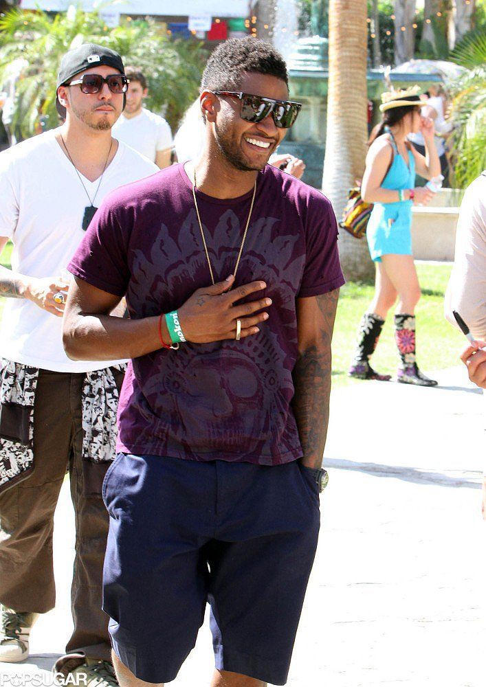 Usher laughed during a show in 2011.