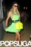 Paris Hilton showed off her neon dress and bag at Coachella's second weekend in 2012.