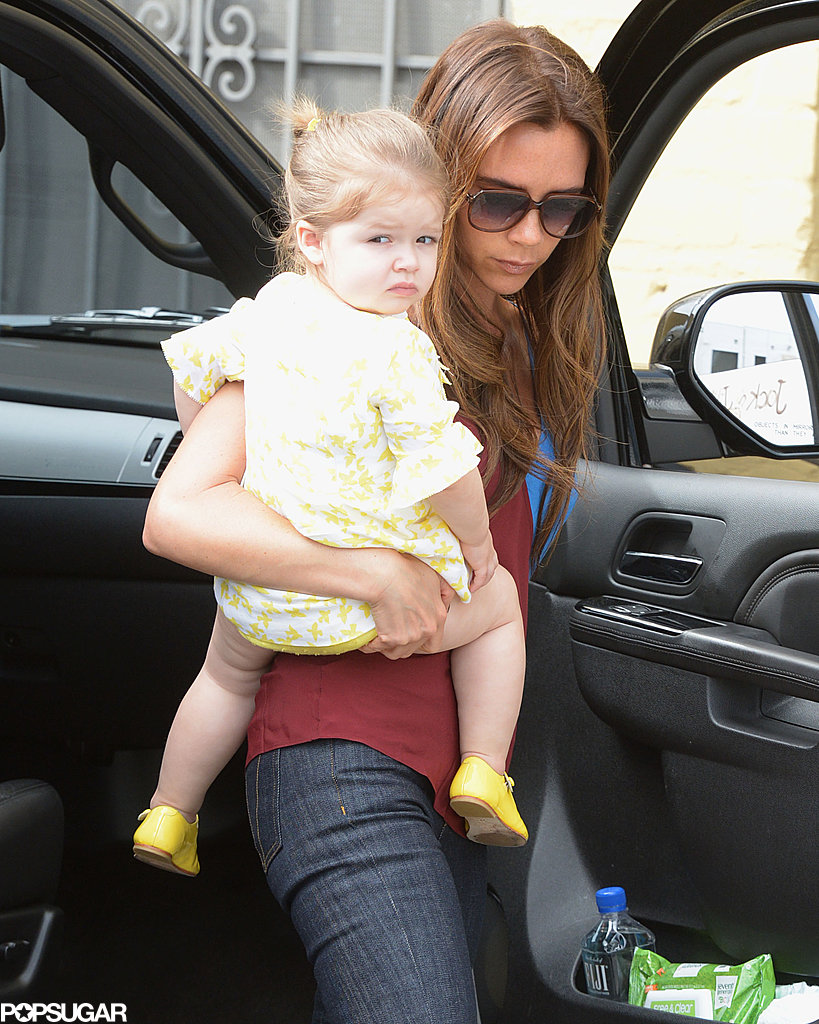 Victoria Beckham dressed Harper Beckham in a yellow dress for a lunch date in LA.