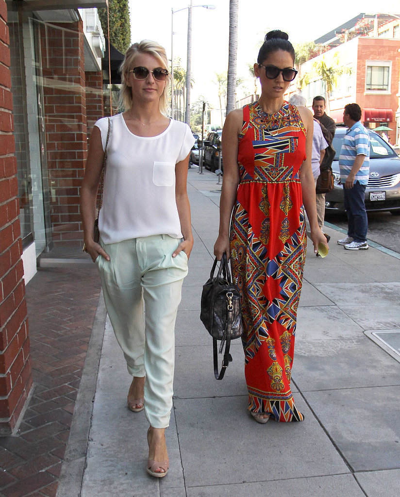 Julianne Hough and Olivia Munn got their nails done together in LA, both looking in adorable Springy ensembles. Julianne paired a white tee with mint-colored trousers, while Olivia stood out in a bright red printed maxi dress.