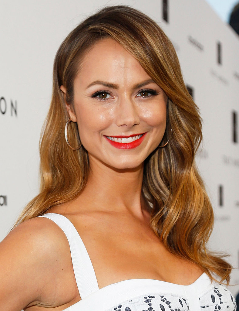 Stacy Keibler showed off a classic approach to beauty with soft, glamorous waves and bright red lipstick.