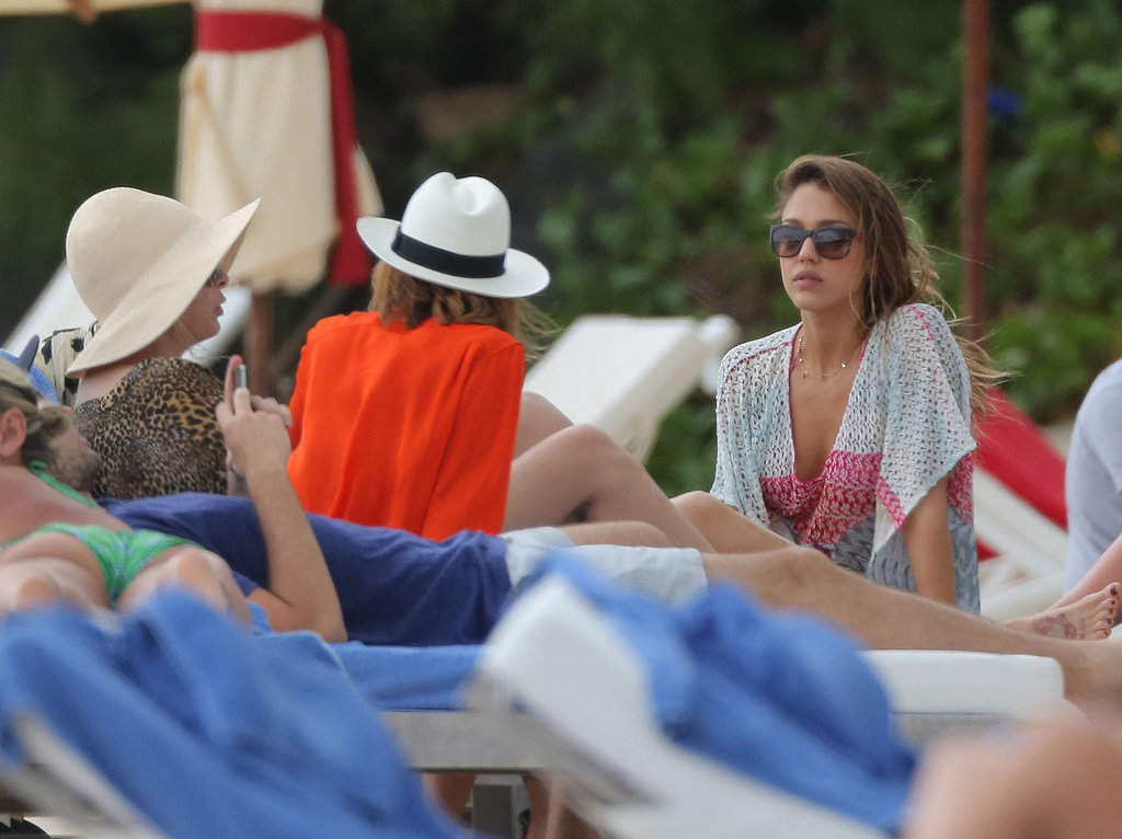Jessica Alba chatted with friends by the pool in St. Barts on Friday.