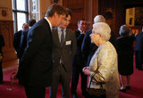 Eddie Redmayne and director Tom Hooper chatted with the queen.