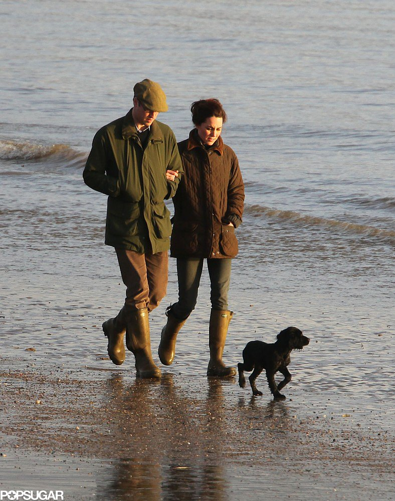 Prince William and Kate Middleton expanded their family with the adoption of their first pet, Lupo, and took him for a beach walk in Wales in January 2012.