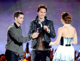 Emma Watson accepted her Trailblazer Award honor from Logan Lerman and Eddie Redmayne at the MTV Movie Awards.
