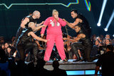 Rebel was surrounded by handsome men in leather, while she rocked a pink tracksuit.