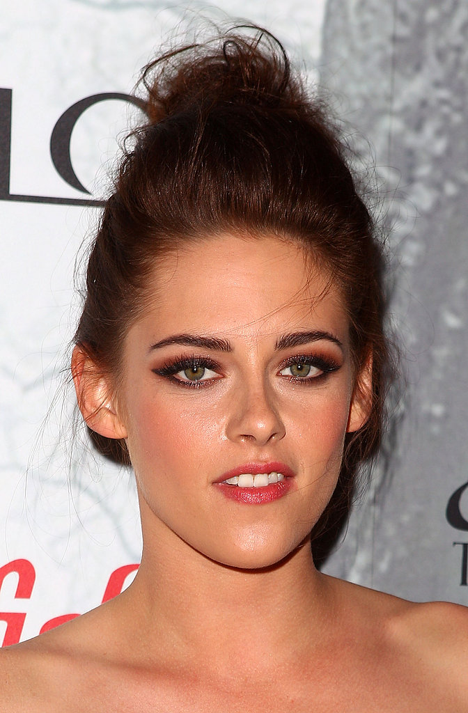 Kristen swept her hair into a high topknot and smoked her eyes in orange for the Australian premiere of Snow White and the Huntsman in 2012.