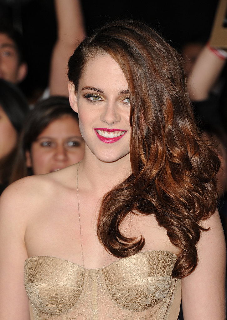 For the final premiere of the Twilight series in 2012, Kristen went for full-on glamor. Silky curls, gilded eye shadow, and hot-pink lipstick added to her wow factor.