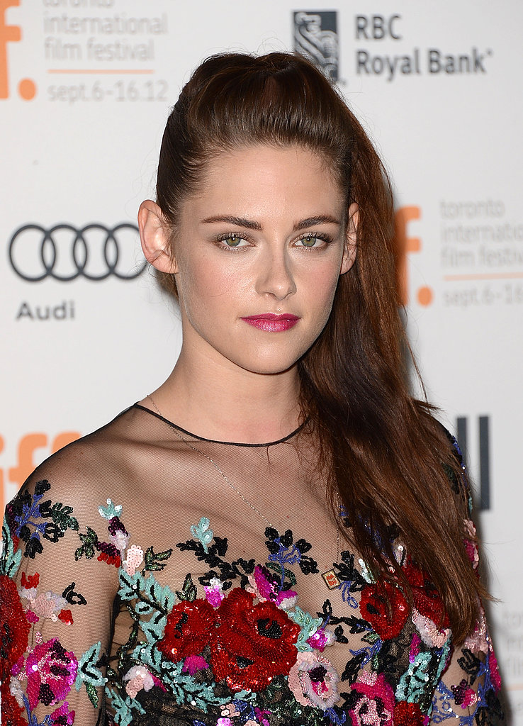 A long, side-swept style and pink lipstick upped Kristen's glamour at the premiere for On the Road in 2012.