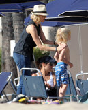 Naomi Watts put sunscreen on her sons in Santa Monica.