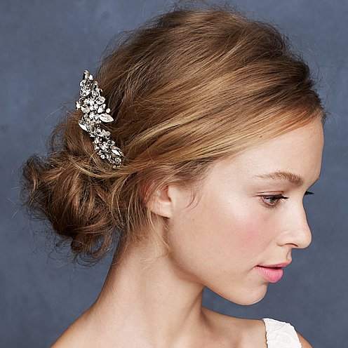 If you plan on skipping the veil, decorate your hair with this beautiful J.Crew pinwheel crystal pin ($118).