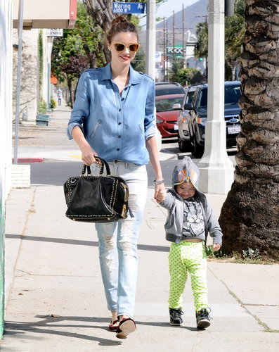 Miranda Kerr spent a sunny afternoon with Flynn in Hollywood in a denim-on-denim look. She jazzed up her look with a studded bag and snazzy accessories, including glittery gold sunglasses and velvet loafers, both by Miu Miu.