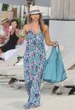 Jessica covered up her bikini with a printed maxi dress and her trusty Tory Burch fedora. Throw this Sam & Lavi printed maxi dress ($180) over your swimsuits to channel Jessica's style.
