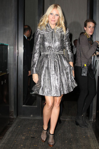 Gwyneth shined in a dazzling metallic trench and caged Christian Louboutin booties in NYC.