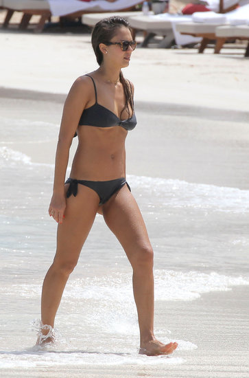 On another beach day in St. Barts, Jessica ditched the brights for a black bikini with tortoiseshell sunglasses. Get her look with this similar black bikini ($213).