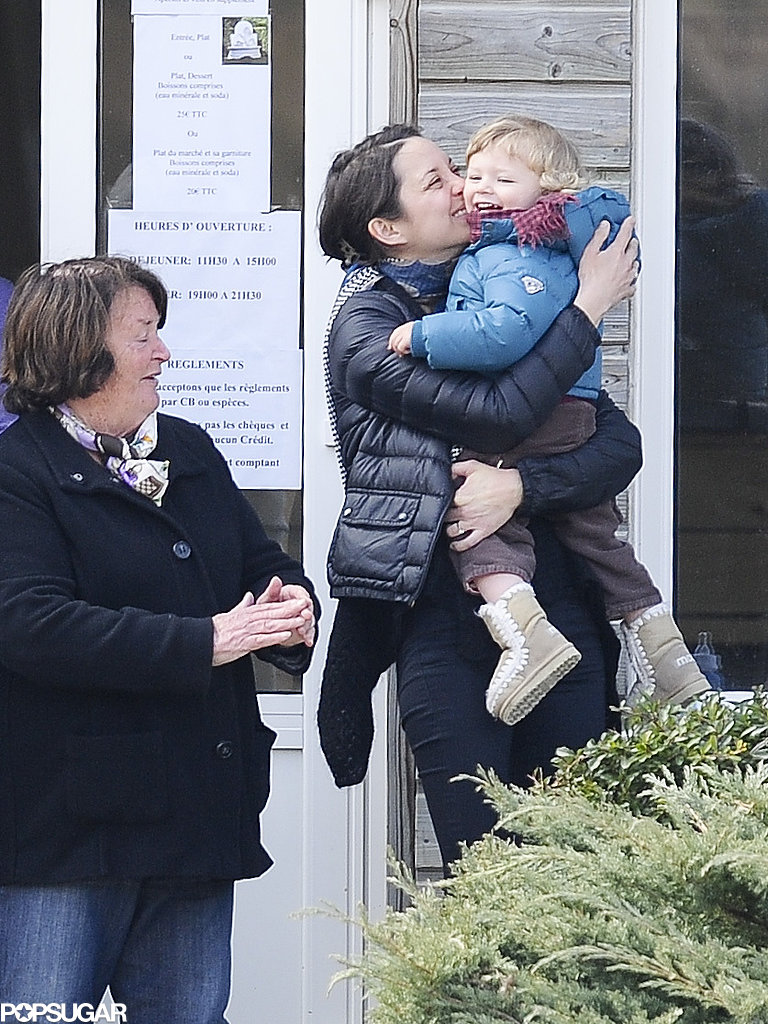 Marion Cotillard planted a sweet kiss on her son Marcel's cheek while cheering on Guillaume Canet at the International Jump Bost in Barbizon, France, in April 2013.