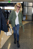 Gwyneth Paltrow took off from LAX airport looking utilitarian-cool in this Current/Elliott army green jacket ($266), cropped skinny jeans, a white blouse, black booties, and a studded Gucci bag.