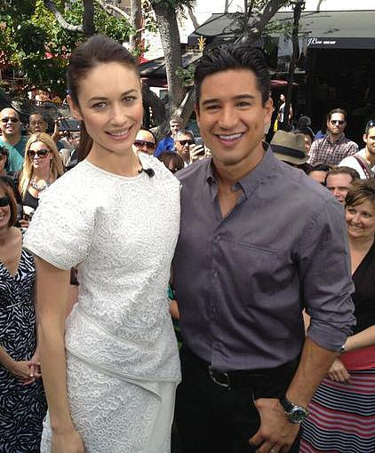 Mario Lopez talked Oblivion with a white-dress-clad Olga Kurylenko. Source: Twitter user MarioLopezExtra