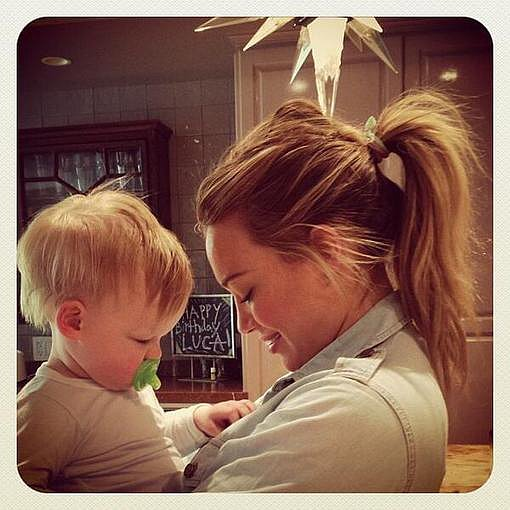 "Hilary Duff cuddled with son Luca Comrie, who ""loves buttons."" Source: Twitter user HilaryDuff"