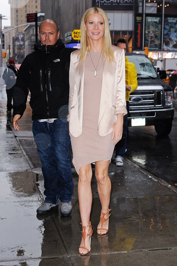 Gwyneth entered the GMA studio in NYC, layering a satin blazer over her asymmetrical dress and refined leather sandals.