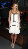 Jennifer Morrison evoked a '20s vibe with this white-and-gold swing dress and T-strap heels.