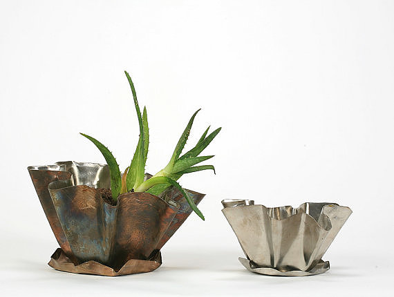 Add a unique touch to your garden or patio with these recycled stainless steel planters ($40).