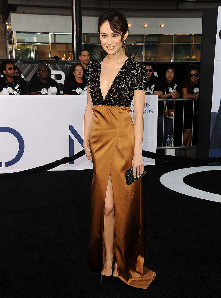 Beauty Olga Kurylenko showed off another gorgeous look, this time in a low-cut Burberry gown at the LA premiere of Oblivion.