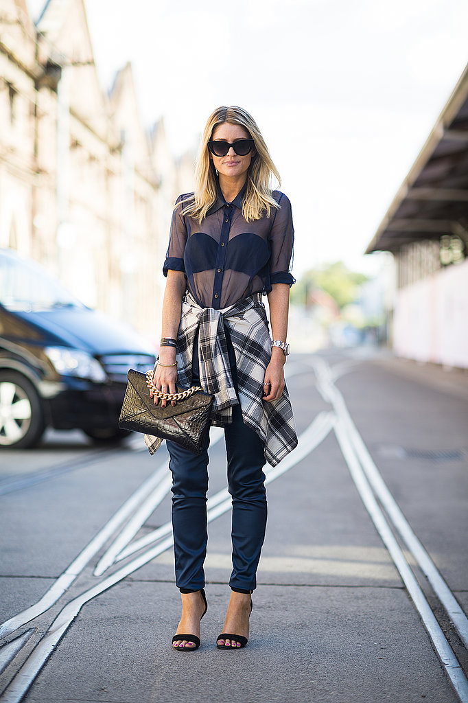 We can't get over this cool-girl combo that made use of a sheer blouse, punky plaid, and sexier heels. Source: Le 21ème | Adam Katz Sinding