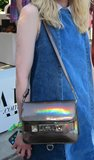 This Proenza Schouler PS11 crossbody bag reflected only good vibes in this metallic hologram finish.