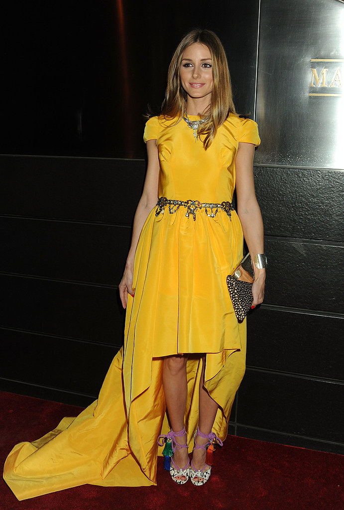 Another testament to Olivia Palermo's styling prowess — the fashion darling gave a brilliantly hued Katie Ermilio gown her signature eclectic-glam finish with Jimmy Choo sandals and ample accessories.