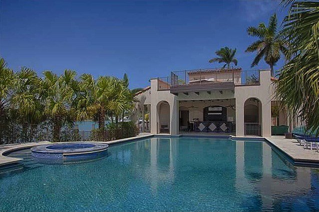 The poolhouse with a roof deck makes this Miami home the perfect spot for entertaining guests.  Source: Coldwell Banker Real Estate