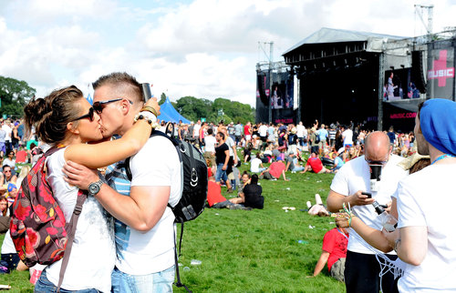 Fans embraced at the V Festival at Weston Park in Staffordshire, England.