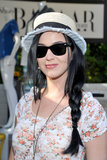 Katy Perry's side braid and bucket hat combined to create the ideal Coachella festival style at the Harper's Bazaar pool party in April.