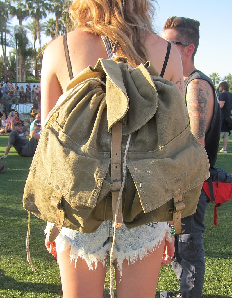 An oversize army-green backpack can fit your entire day's essentials and double as a pillow while you lounge on the lawn.