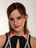 Bold pink lips and a half updo were Emma's choice for this year's People's Choice Awards.