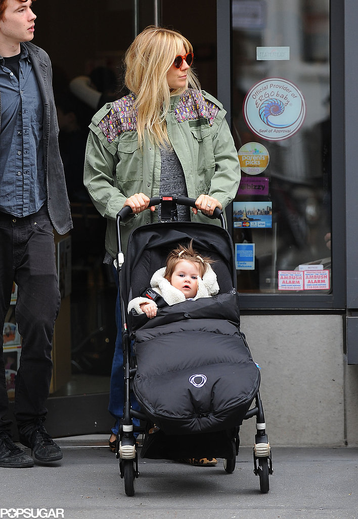Sienna Miller donned a green jacket to take Marlowe for a walk in NYC.